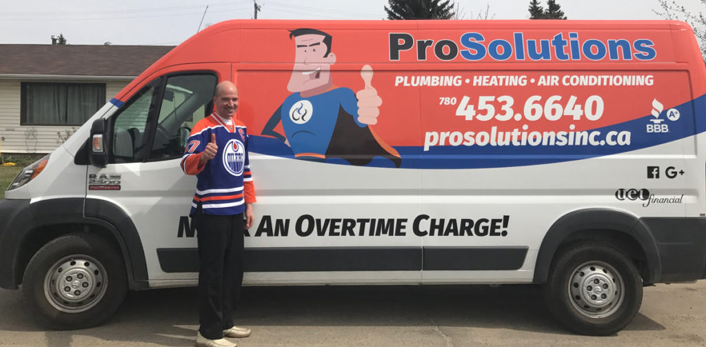 ProSolutions Inc. owner Jason Billey stand beside one of the company installation trucks